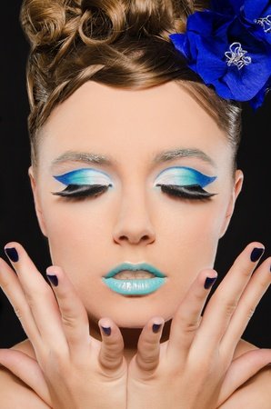 Vertical portrait of woman with blue make-up