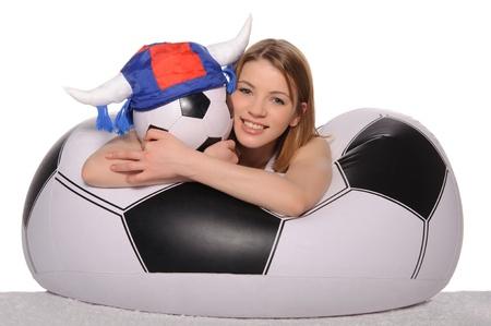 pleasantness: Happy football cheerleader with ball