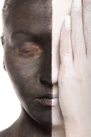 antipode: woman in two-color makeup covers eye with hand Stock Photo