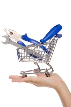 tools in shopping trolley on the palm photo