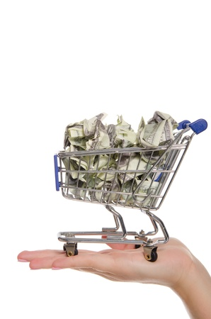 crumpled dollars in shopping trolley on the palm photo