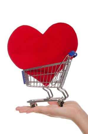 heart symbol in shopping trolley on the palm photo