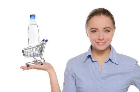 Bottle of water in shopping trolley on the palm photo