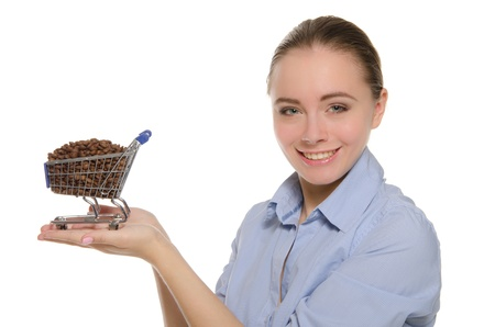 Woman with coffee beans in shopping trolley photo