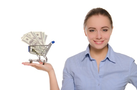woman with dollar bills in shopping trolley photo