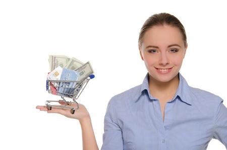 お金とショッピング カート内のカードを持つ女性 写真素材