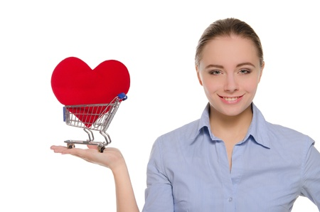 woman with heart symbol in shopping cart photo