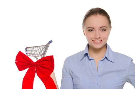 woman with red bow on the shopping cart photo