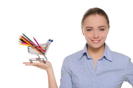 Woman with colored pencils in shopping trolley photo