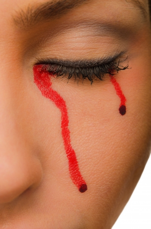 haemorrhage: Blood flows from the closed eyes of the woman close up Stock Photo