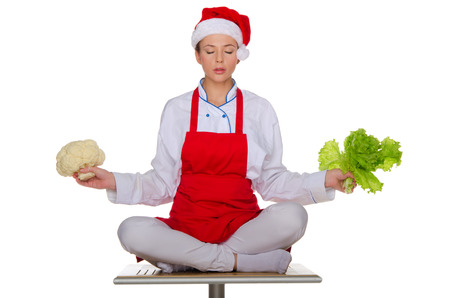 The meditator cook with vegetables isolated on white Stock Photo