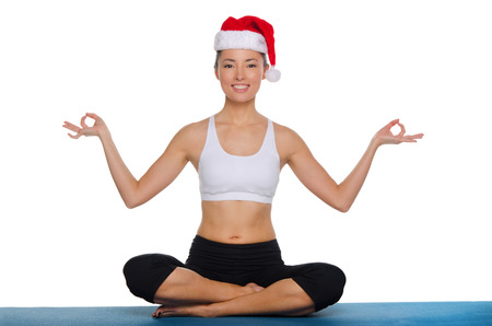 Asian girl doing yoga in a red cap Isolated on white photo