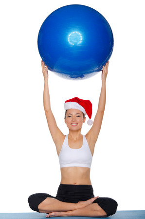 Athlete with the ball and hat of Santa Claus photo