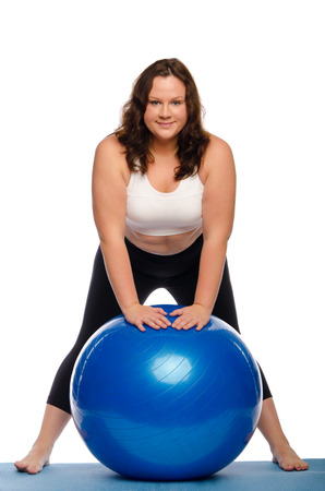 Fat woman with a ball Isolated on white photo