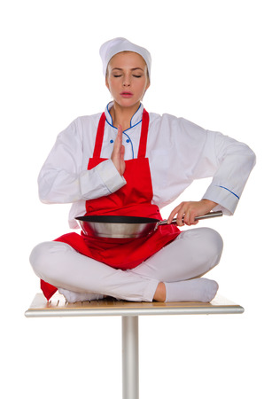 The meditator cook with frying pan isolated on white