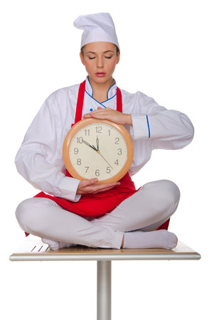 meditates: Cook meditates with clock isolated on white Stock Photo