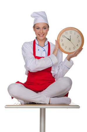 horologe: Smiling chef holding a clock isolated on white