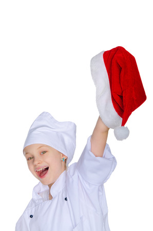 Cheerful chef girl with Santa hat isolated on white