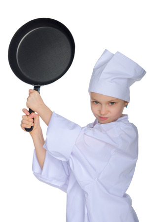 Young chef threatens frying pan isolated on white photo