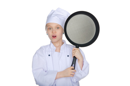 unexpectedness: Surprised young chef with a pan isolated on white