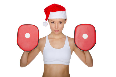 Woman protects herself in Santa Claus hat isolated on white photo