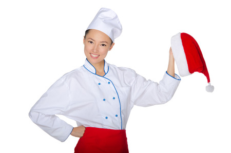 Asian chef invites to a Christmas party isolated on white photo