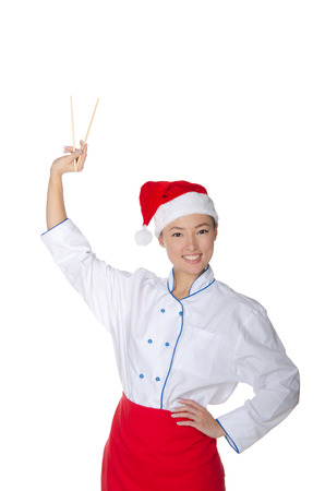 Asian in Santa Claus hats held up chopsticks isolated on white photo