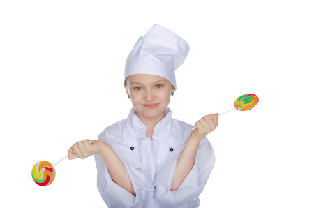 Young chef with colorful candy isolated on white photo