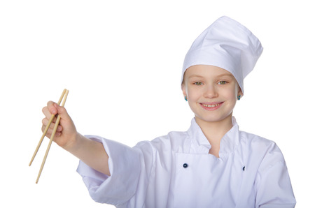 Girl in the form of chef with chopsticks isolated on white photo