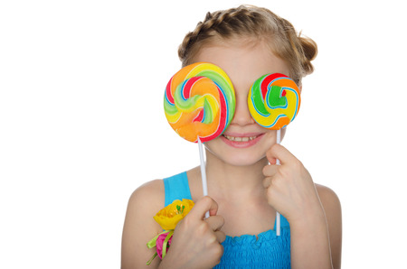 Girl closed her eyes lollipop isolated on white photo