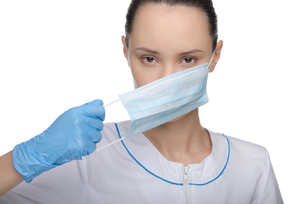 Doctor puts on or takes off his mask isolated on white photo