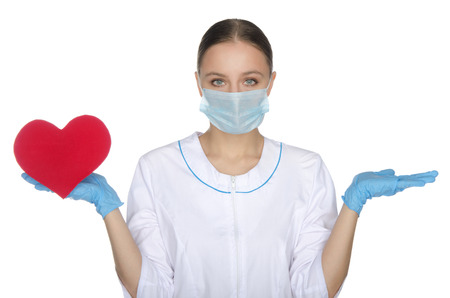 weighs: Doctor woman in mask weighs on hand red heart