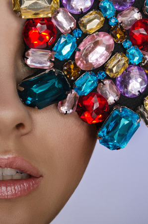 Portrait of beautiful woman with multicolored stones photo