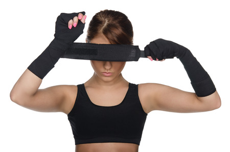 Young woman covering her eyes boxing bandages photo