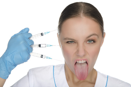 Doctor keeps syringes and shows tongue isolated on white photo