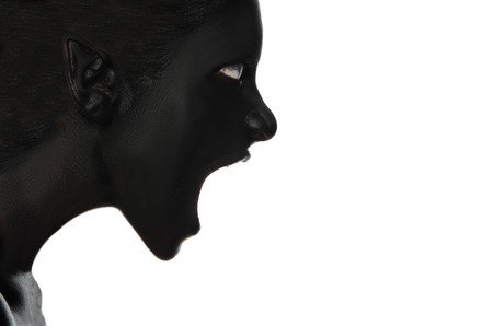 malice: Screaming woman in black paint on white background