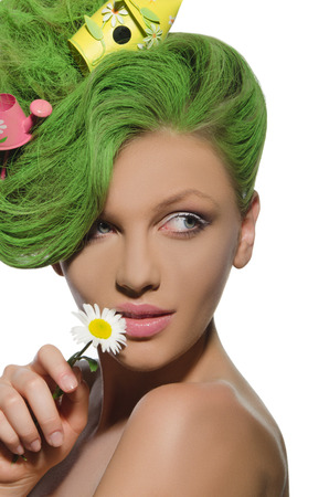 Woman with watering can and starling house in her green hair photo