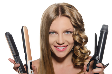 curling irons: Young woman with  smile holds curling iron
