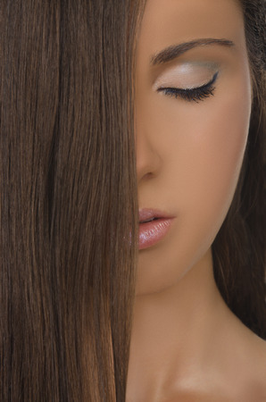 pleasantness: vertical portrait of brunette beautiful woman with straight hair Stock Photo