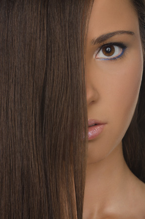 pleasantness: vertical portrait of beautiful brunette woman with straight hair