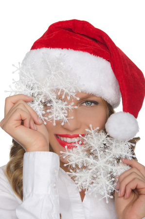 pleasantness: Attractive woman in Santa hat with snowflake isolated in white