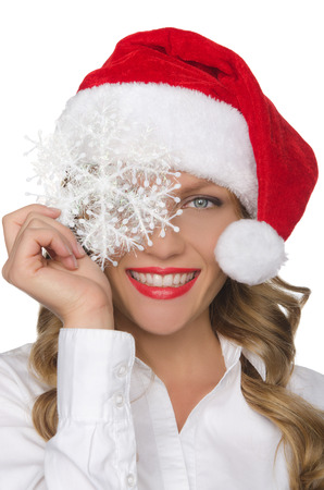 pleasantness: Beautiful woman in Santa hat with snowflake isolated in white Stock Photo