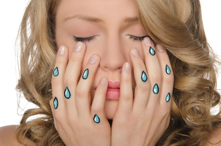 disillusionment: Beautiful weeping woman with tears in hands