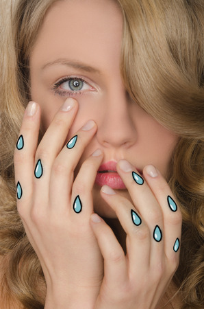 disillusionment: crying portrait of beautiful woman with tears in hands