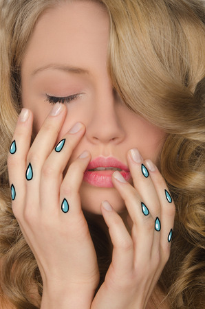 disillusionment: Portrait of young woman with tears in hands