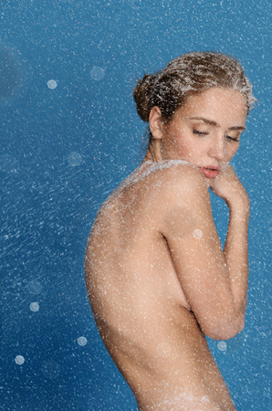 nipple breast: Young nude sexy woman with snow in blue
