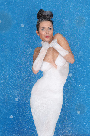 Beautiful sexy happy woman in gown of snow photo