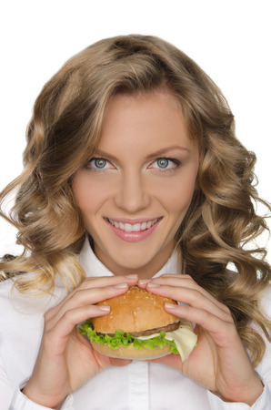 stage make up: Beautiful young woman with hamburger isolated on white