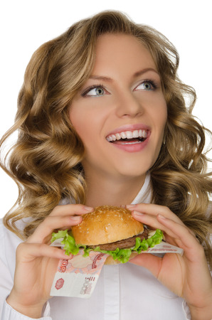 pleasantness: Young woman with hamburger from RUR looking away isolated on white