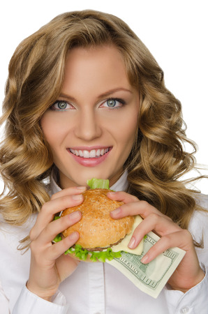 pleasantness: Young woman with burger of dollars isolated on white